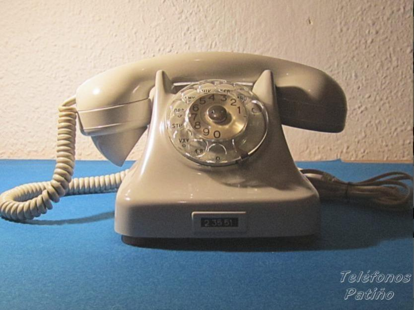 Teléfono antiguo de sobremesa perla